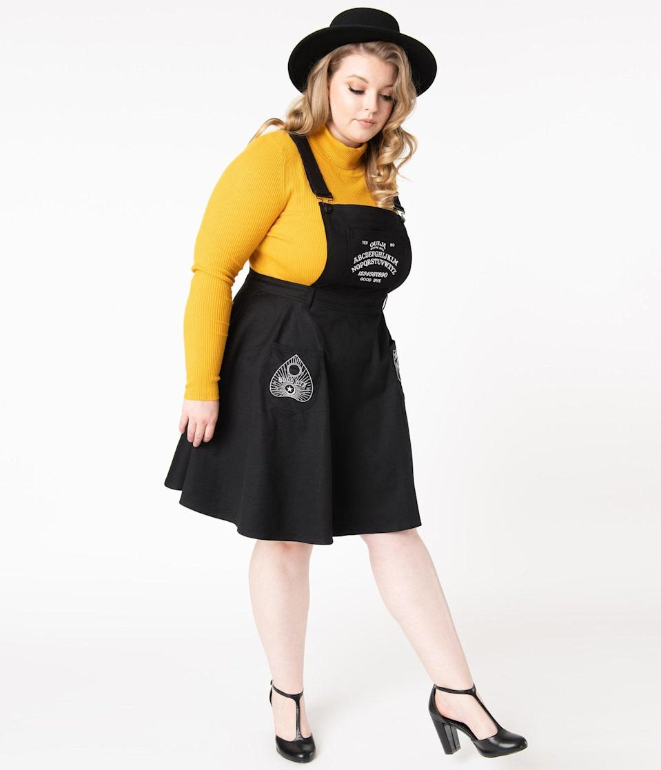 <p>The ouija accents on the <span>Hell Bunny Plus Size Black Samara Pinafore Dress</span> ($82) make it extremely spooky.</p>