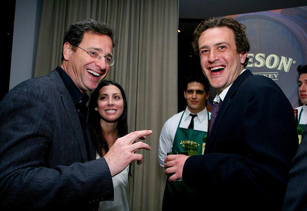 "Show narrator Bob Saget and Jason Segel share a laugh while Bob's girlfriend, Michelle Ghaltchi, looks on. Alexandra Wyman/<a href=""http://www.wireimage.com"" target=""new"">WireImage.com</a> - March 13, 2008"