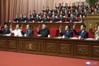 """In this photo provided by the North Korean government, North Korean leader Kim Jong Un, bottom center, attends a ruling party congress in Pyongyang, North Korea Tuesday, Jan. 12, 2021. Kim vowed all-out efforts to bolster his country's nuclear deterrent during the major ruling party meeting where he earlier laid out plans to work toward salvaging the broken economy. Independent journalists were not given access to cover the event depicted in this image distributed by the North Korean government. The content of this image is as provided and cannot be independently verified. Korean language watermark on image as provided by source reads: """"KCNA"""" which is the abbreviation for Korean Central News Agency. (Korean Central News Agency/Korea News Service via AP)"""