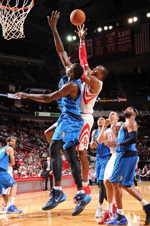 HOUSTON, TX - OCTOBER 21: Dwight Howard #12 of the Houston Rockets shoots the ball against Samuel Dalembert #1 of the Dallas Mavericks during a 2013 NBA pre-season game on October 21, 2013 at the Toyota Center in Houston, Texas. (Photo by Bill Baptist/NBAE via Getty Images)