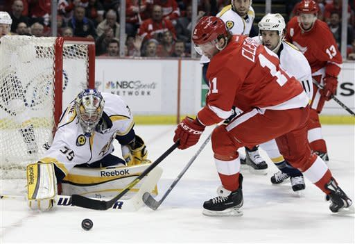 Nashville Predators goalie Pekka Rinne (35) of Finland deflects a shot by Detroit Red Wings right wing Danny Cleary (11) during the first period of Game 4 of an NHL hockey Stanley Cup first-round playoff series in Detroit, Tuesday, April 17, 2012. (AP Photo/Carlos Osorio)