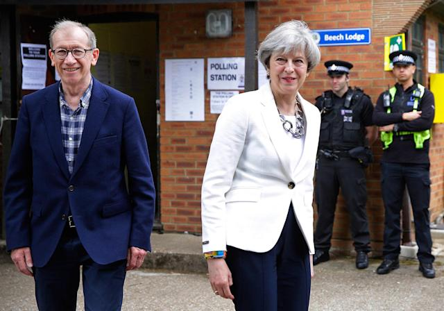 <p>Britain's Prime Minister Theresa May leaves with her husband Philip after voting in the general election at polling station in Maidenhead, England, Thursday, June 8, 2017. (Photo: Alastair Grant/AP) </p>