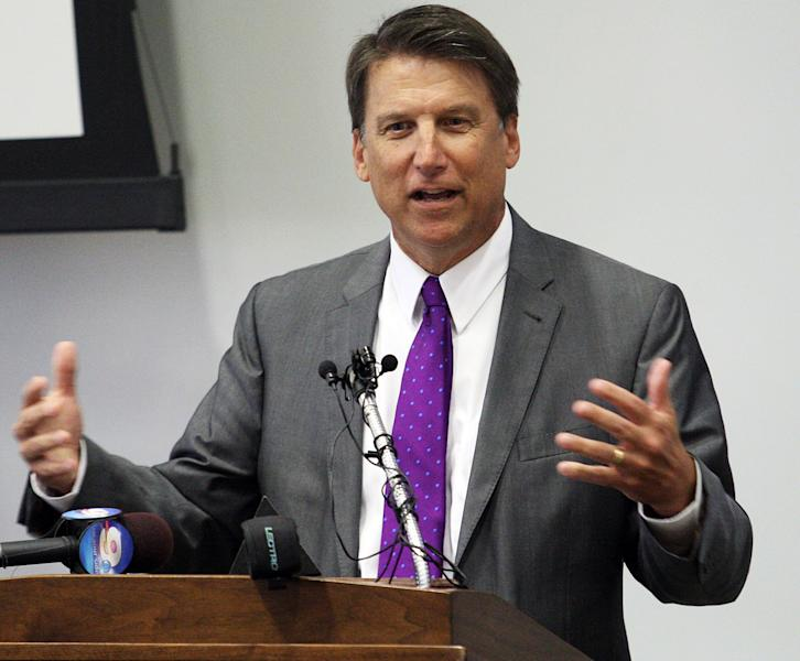 FILE - In this Aug. 16, 2013 file photo, North Carolina Gov. Pat McCrory speaks during a news conference at the East Carolina School of Dental Medicine in Greenville, N.C. Documents and interviews collected by The Associated Press show how Duke's lobbyists prodded Republican legislators to tuck a 330-word provision in a regulatory reform bill running nearly 60 single-spaced pages. Though the bill never once mentions coal ash, the change allowed Duke to avoid any costly cleanup of contaminated groundwater leaching from its unlined dumps toward rivers, lakes and the drinking wells of nearby homeowners. Passed overwhelmingly by the GOP-controlled legislature, the bill was signed into law by Gov. Pat McCrory, a pro-business Republican who worked at Duke for 28 years. (AP Photo/The Daily Reflector, Rhett Butler)