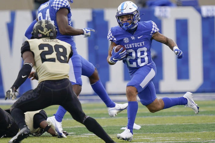 Kentucky wide receiver Rahsaan Lewis (28) runs with the ball during the first half of an NCAA college football game against Vanderbilt, Saturday, Nov. 14, 2020, in Lexington, Ky. (AP Photo/Bryan Woolston)