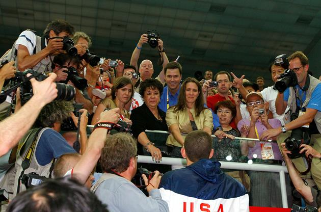 BEIJING - AUGUST 17:  Michael Phelps of the United States makes his way to his family, sister's Whitney, Hilary and mother Debbie in the stands after receiving his eighth gold medal after the Men's 4x100 Medley Relay at the National Aquatics Centre during Day 9 of the Beijing 2008 Olympic Games on August 17, 2008 in Beijing, China.  The United States team set a new world record with a time of 3:29:34.  (Photo by Cameron Spencer/Getty Images)