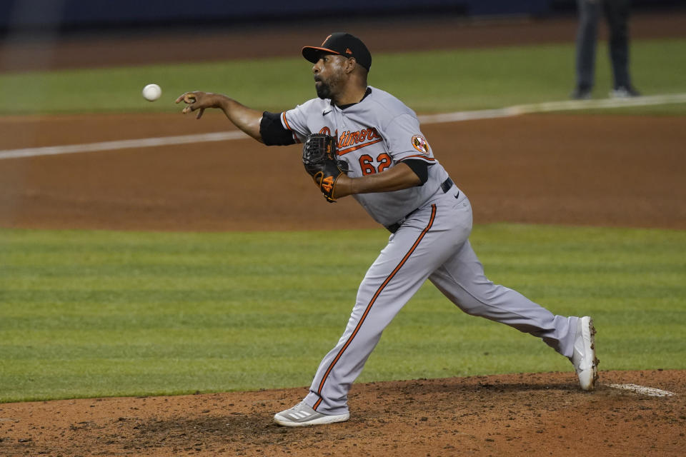 Baltimore Orioles relief pitcher Cesar Valdez (62) pitches in the ninth inning of a baseball game against the Miami Marlins, Tuesday, April 20, 2021, in Miami. (AP Photo/Marta Lavandier)