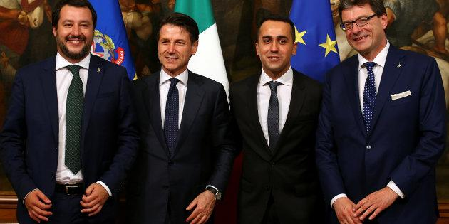 Newly appointed Italian Prime Minister Giuseppe Conte poses with undersecretary for Prime Minister Giancarlo Giorgetti, Interior Minister Matteo Salvini and Minister of Labor and Industry Luigi Di Maio at Chigi palace in Rome, Italy, June 1, 2018. REUTERS/Alessandro Bianchi