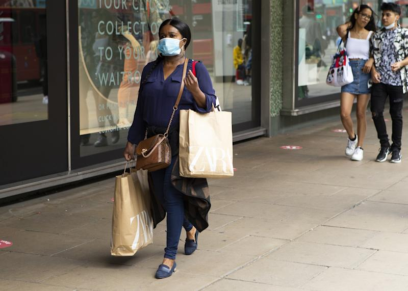 A shopper with a protective face mask walking down Oxford Street as people in London, UK on July 11, 2020 prepare for the possibility of Face coverings becoming mandatory in shops and other public places across the UK. (Photo by Jacques Feeney/MI News/NurPhoto via Getty Images)