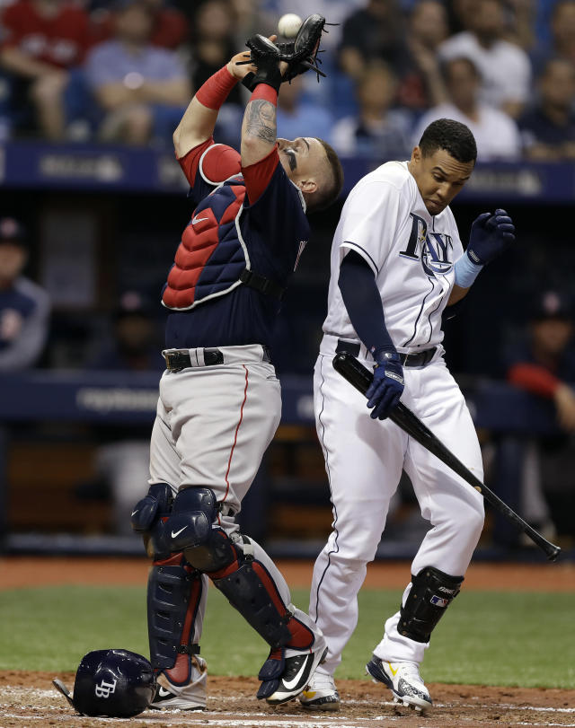 Boston Red Sox catcher Christian Vazquez makes the catch on a pop out by Tampa Bay Rays' Carlos Gomez, right, during the fourth inning of a baseball game Friday, March 30, 2018, in St. Petersburg, Fla. (AP Photo/Chris O'Meara)