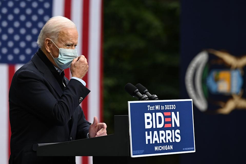 Democratic presidential nominee Joe Biden adjusts his facemask as he speaks during a campaign event in Grand Rapids, Mich., on Oct. 2, 2020.