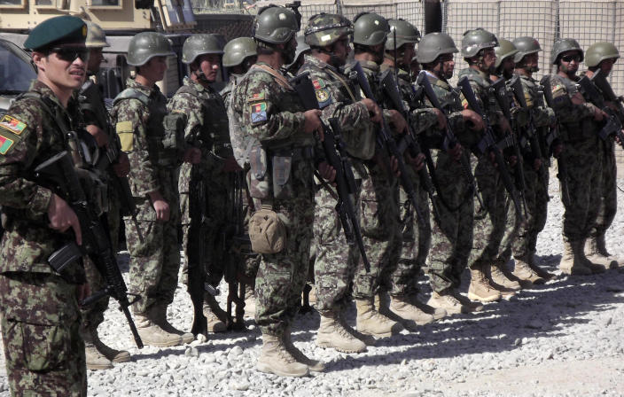 This photo taken Oct. 10, 2012 shows Afghan National Civil Order Police (ANCOP) lining up to get counter-IED training at Forward Operating Base Warrior in Gelan district, Ghazni province, Afghanistan. (AP Photo/Robert Burns)