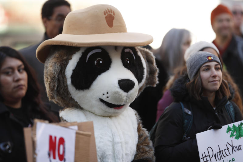 Ranger Rick from the National Wildlife Federation attends a rally of advocates to voice opposition to efforts by the Trump administration to weaken the National Environmental Policy Act, which is the country's basic charter for protection of the outdoors, on Tuesday, Feb. 11, 2020, in Denver. (AP Photo/David Zalubowski)