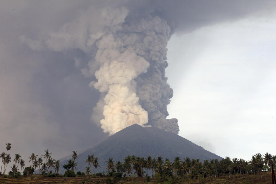 <p>A view of the Mount Agung volcano erupting in Karangasem, Bali, Indonesia, Nov. 27, 2017. The volcano on the Indonesian tourist island of Bali erupted for the second time in a week on Saturday, disrupting international flights even as authorities said the island remains safe. (Photo: Firdia Lisnawati/AP) </p>