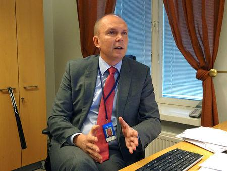 Head of the Finnish government's communication department Mantila speaks at his office in Helsinki