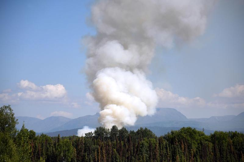 Smoke rises from a wildfire on July 3, 2019 south of Talkeetna, Alaska near the George Parks Highway. Alaska is bracing for a dangerous fire season with record warm temperatures and dry conditions in parts of the state. | Lance King—Getty Images