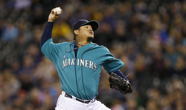 Seattle Mariners starting pitcher Felix Hernandez throws against the Oakland Athletics in the first inning of a baseball game on Friday, Sept. 27, 2013, in Seattle. (AP Photo/Ted S. Warren)
