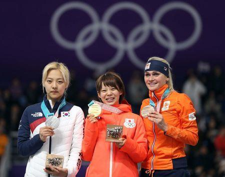 Speed Skating - Pyeongchang 2018 Winter Olympics - Women's Mass Start competition finals - Gangneung Oval - Gangneung, South Korea - February 24, 2018 - Bo-Reum Kim of South Korea, Nana Takagi of Japan and Irene Schouten of the Netherlands pose with medals. REUTERS/Lucy Nicholson