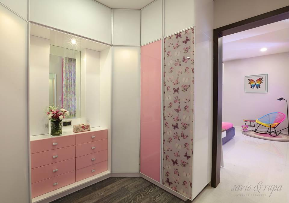 Kids walk-in wardrobe with custom printed glass shutters.