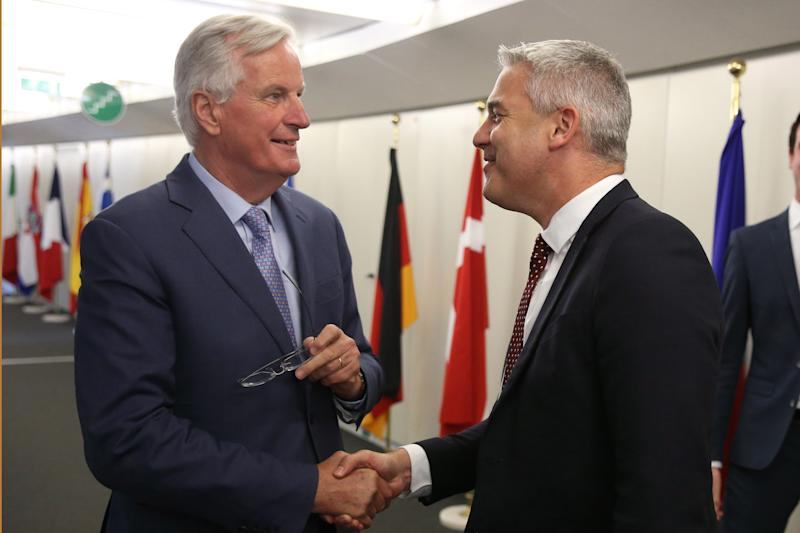 UK Brexit minister Stephen Barclay (R) shakes hands with EU negotiator Michel Barnier ahead of their meeting in Brussels, on July 9, 2019. (Photo by François WALSCHAERTS / AFP) (Photo credit should read FRANCOIS WALSCHAERTS/AFP/Getty Images)