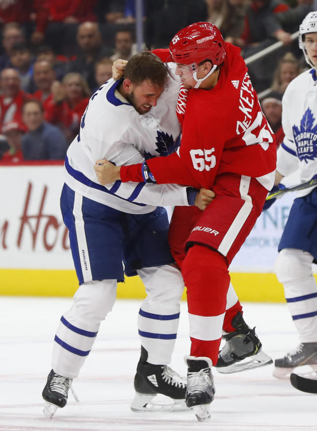 Toronto Maple Leafs left wing Josh Leivo (32) and Detroit Red Wings defenseman Danny DeKeyser (65) fight during the first period of an NHL hockey game Thursday, Oct. 11, 2018, in Detroit. (AP Photo/Paul Sancya)