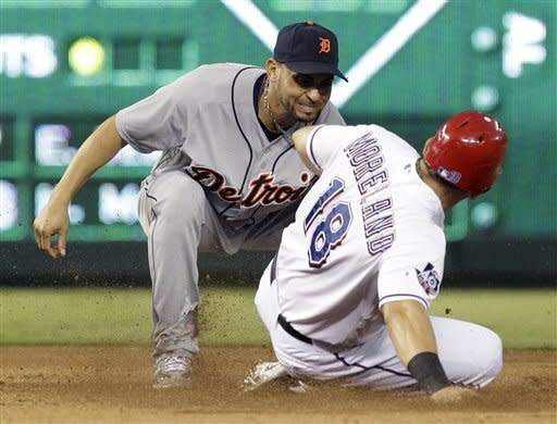 Detroit Tigers second baseman Omar Infante, left, tags out Texas Rangers' Mitch Moreland (18) trying to steal second base during the fourth inning of a baseball game on Friday, Aug. 10, 2012, in Arlington, Texas. (AP Photo/LM Otero)
