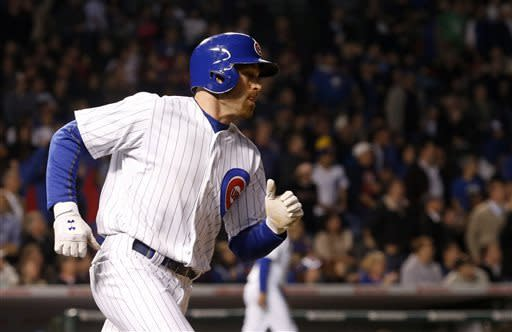 Chicago Cubs' Nate Schierholtz rounds the bases after hitting a two-run home run off St. Louis Cardinals starting pitcher Lance Lynn, also scoring Alfonso Soriano, during the fourth inning of a baseball game, Tuesday, May 7, 2013, in Chicago. (AP Photo/Charles Rex Arbogast)
