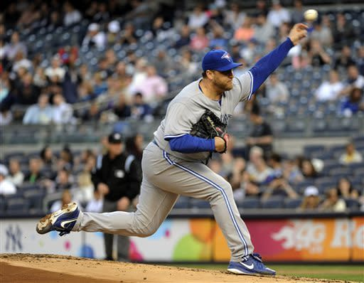 Toronto Blue Jays pitcher Mark Buehrle delivers the ball to the New York Yankees during the first inning of a baseball game, Friday, May 17, 2013, at Yankee Stadium in New York. (AP Photo/Bill Kostroun)