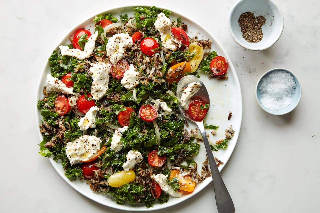 "What's creamed mozzarella? It's basically a creamy homemade substitute for burrata, made by mixing fresh mozz with sour cream, lemon zest, and juice. And it's brilliant. <a href=""https://www.epicurious.com/recipes/food/views/massaged-kale-with-tomatoes-creamed-mozzarella-and-wild-rice?mbid=synd_yahoo_rss"">See recipe.</a>"