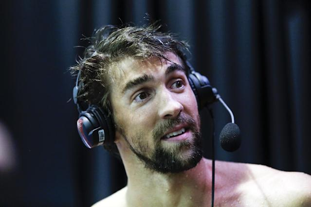 Michael Phelps is interviewed after winning the 100-meter butterfly in the at the Arena Grand Prix swim meet in Charlotte, N.C., Friday, May 16, 2014. Phelps won the race with a time of 52.13. (AP Photo/Nell Redmond)