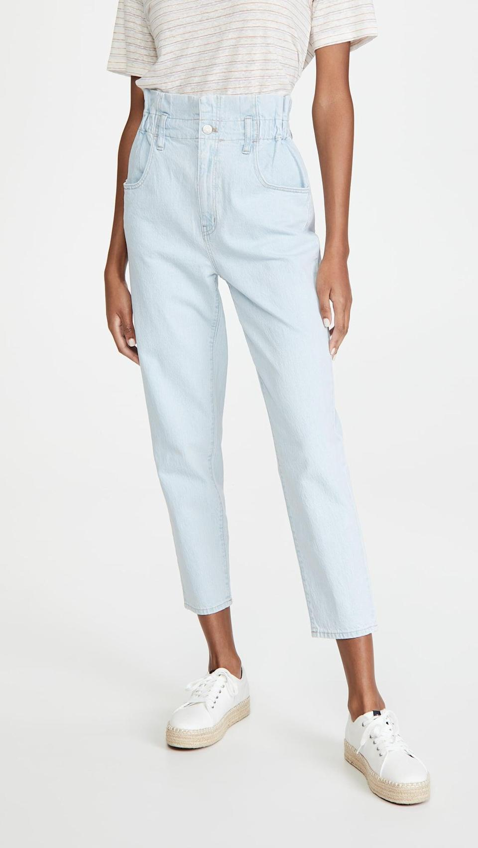"<p>These fun <a href=""https://www.popsugar.com/buy/Madewell-Classic-Straight-Paperbag-Jeans-585703?p_name=Madewell%20Classic%20Straight%20Paperbag%20Jeans&retailer=shopbop.com&pid=585703&price=98&evar1=fab%3Aus&evar9=45615413&evar98=https%3A%2F%2Fwww.popsugar.com%2Ffashion%2Fphoto-gallery%2F45615413%2Fimage%2F47583285%2FMadewell-Classic-Straight-Paperbag-Jeans&list1=shopping%2Cdenim%2Cwinter%2Cwinter%20fashion&prop13=mobile&pdata=1"" class=""link rapid-noclick-resp"" rel=""nofollow noopener"" target=""_blank"" data-ylk=""slk:Madewell Classic Straight Paperbag Jeans"">Madewell Classic Straight Paperbag Jeans</a> ($98) would look great with a tee.</p>"