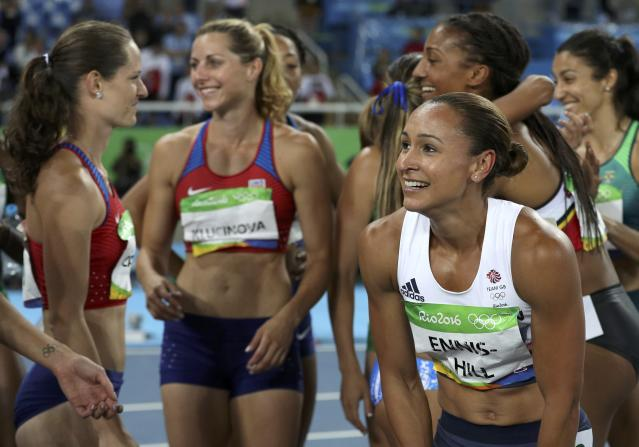 2016 Rio Olympics - Athletics - Final - Women's Heptathlon 800m - Olympic Stadium - Rio de Janeiro, Brazil - 13/08/2016. Silver medal winner Jessica Ennis-Hill (GBR) of Britain (R) reacts after the event. REUTERS/Phil Noble FOR EDITORIAL USE ONLY. NOT FOR SALE FOR MARKETING OR ADVERTISING CAMPAIGNS.
