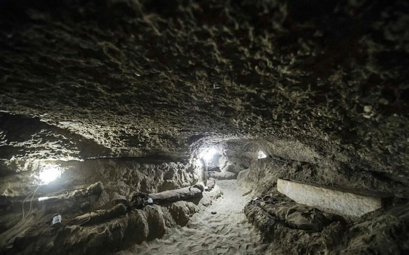 "Egyptian archaeologists have discovered 17 non-royal mummies in the desert catacombs, an ""unprecedented"" find for the area south of Cairo - Credit: AFP"