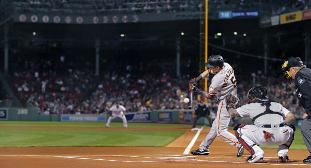 San Francisco Giants' Mike Yastrzemski (5) takes a swing as the lead off batter in a baseball game against the Boston Red Sox at Fenway Park in Boston, Tuesday, Sept. 17, 2019. Yastrzemski is the grandson of Red Sox great and Hall of Famer Carl Yastrzemski. Yastrzemski struck out in his plate appearance. (AP Photo/Charles Krupa)