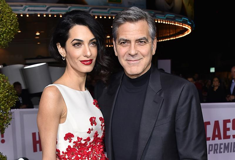 "FILE - In this Feb. 1, 2016 file photo, Amal Clooney, left, and George Clooney arrive at the world premiere of ""Hail, Caesar!"" in Los Angeles. The two wed on Sept. 27, 2014, in Venice, Italy. (Photo by Jordan Strauss/Invision/AP, File)"