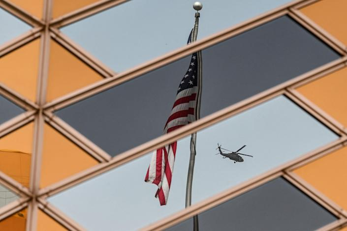 The US national flag is reflected on the windows of the US embassy building in Kabul on July 30, 2021.  The United States said on August 12, 2021 it was sending troops to the international airport in Afghanistan's capital Kabul to pull out US embassy staff as the Taliban makes rapid gains.