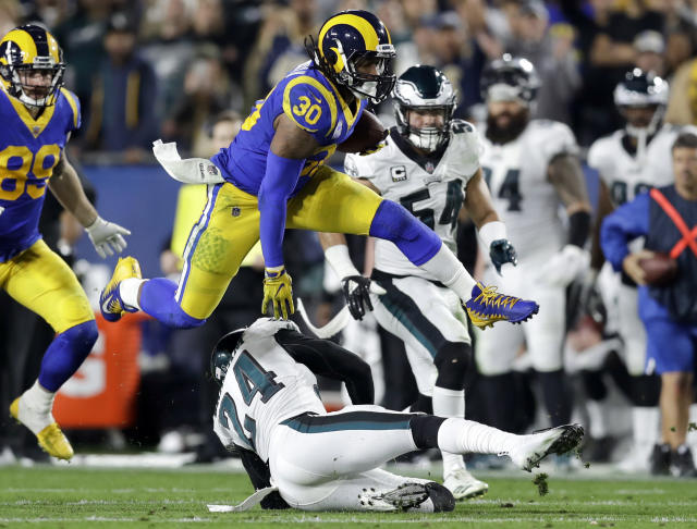 FILE - In this Dec. 16, 2018, file photo Los Angeles Rams running back Todd Gurley runs against the Philadelphia Eagles during the first half in an NFL football game in Los Angeles. Gurley still is not shedding much light on the injured knee that limited him down the stretch with the Rams. He was in camp for the opening of the Rams offseason program Monday, April 15, 2019, in their first team activities since their Super Bowl loss to New England. (AP Photo/Marcio Jose Sanchez, File)