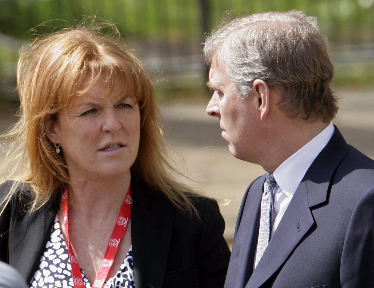 Sarah Ferguson, The Duchess of York talks with ex-husband HRH Prince Andrew, The Duke of York as they wait for daughter HRH Princess Beatrice of York to complete the Virgin London Marathon as part of the 'Caterpillar Run' Team, consisting of 32 runners tethered together on April 25, 2010