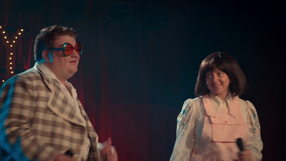 June and James perform at the Tambury Show in season 2 of After Life