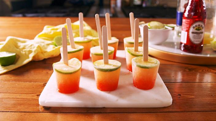 """<p>The ombre effect in these pops is shockingly easy.<br></p><p>Get the recipe from <a href=""""https://www.delish.com/cooking/recipe-ideas/a22550175/tequila-sunrise-pops-recipe/"""" rel=""""nofollow noopener"""" target=""""_blank"""" data-ylk=""""slk:Delish"""" class=""""link rapid-noclick-resp"""">Delish</a>.</p>"""