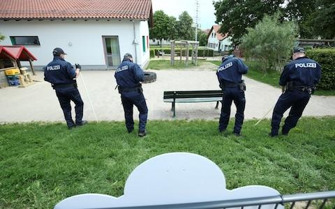 German police officers search neighbouring property around the house of District President of Kassel Walter Luebcke, who was found dead, in Wolfhagen-Istha near Kassel, Germany, June 3, 2019.  - Credit: Reuters