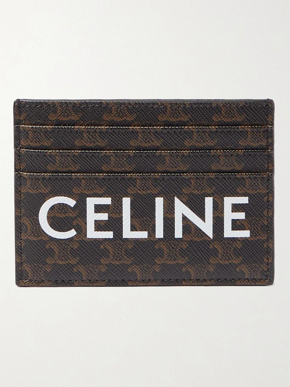 """<p><strong>CELINE HOMME</strong></p><p>mrporter.com</p><p><strong>$315.00</strong></p><p><a href=""""https://go.redirectingat.com?id=74968X1596630&url=https%3A%2F%2Fwww.mrporter.com%2Fen-us%2Fmens%2Fproduct%2Fceline-homme%2Faccessories%2Fcardholders%2Ftriomphe-logo-print-coated-canvas-cardholder%2F560971903940362&sref=https%3A%2F%2Fwww.esquire.com%2Fstyle%2Fmens-accessories%2Fg35924710%2Fmens-luxury-wallets%2F"""" rel=""""nofollow noopener"""" target=""""_blank"""" data-ylk=""""slk:Shop Now"""" class=""""link rapid-noclick-resp"""">Shop Now</a></p><p>Come for the big ol' """"CELINE"""" graphic. Stay for the iconic repeated """"Trimophe"""" logo behind it.</p>"""