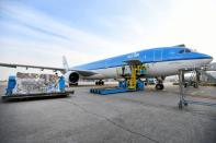 Cooled packages are being transported by airplane at Amsterdam's Schiphol Airport