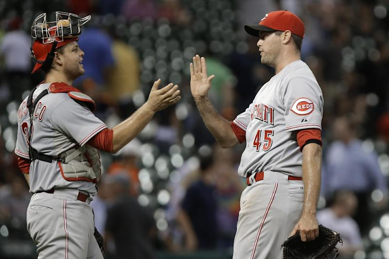 Cincinnati Reds catcher Devin Mesoraco and closing pitcher Sean Marshall (45) celebrate the Reds' 10-0 win over the Houston Astros in a baseball game Tuesday, Sept. 17, 2013, in Houston. (AP Photo/Pat Sullivan)
