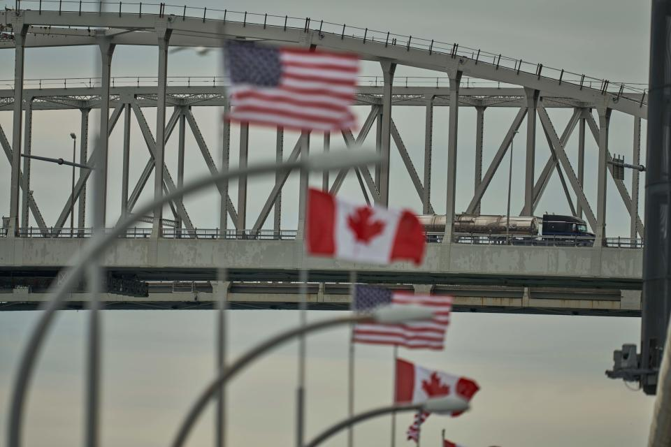 A truck crosses the Bluewater Bridge border crossing between Sarnia, Ontario and Port Huron, Michigan on March 16, 2020. - The Canadian government decided March 16, 2020 to close its borders to most foreign nationals with the exception of Americans. (Photo by Geoff Robins / AFP) (Photo by GEOFF ROBINS/AFP via Getty Images)
