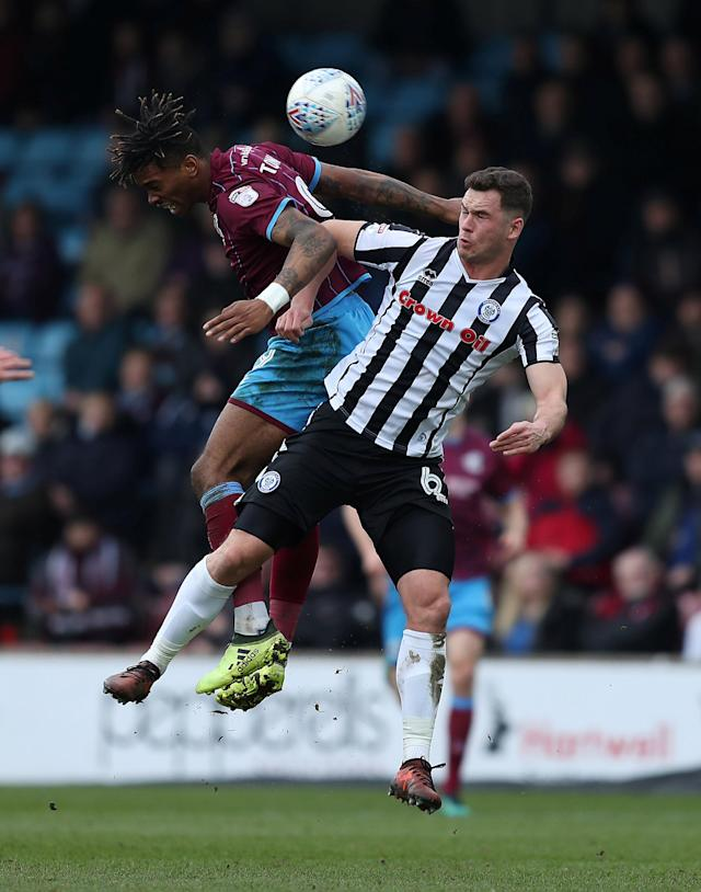 "Soccer Football - League One - Scunthorpe United vs Rochdale - Glanford Park, Scunthorpe, Britain - March 24, 2018 Scunthorpe United's Ivan Toney in action with Rochdale's Harrison McGahey Action Images/John Clifton EDITORIAL USE ONLY. No use with unauthorized audio, video, data, fixture lists, club/league logos or ""live"" services. Online in-match use limited to 75 images, no video emulation. No use in betting, games or single club/league/player publications. Please contact your account representative for further details."