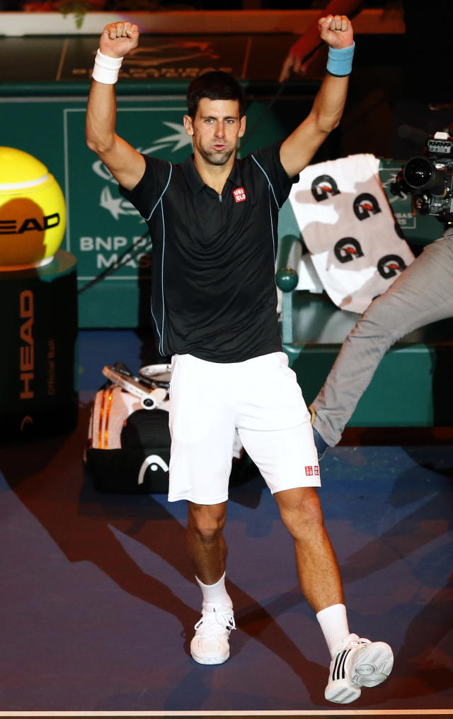 Novak Djokovic of Serbia reacts after winning against Stanislas Wawrinka of Switzerland during their quarter final match, at the Paris Masters tennis at Bercy Arena in Paris, France, Friday, Nov. 1, 2013. (AP Photo/Francois Mori)