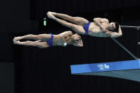Ivan Garcia Navarro and Randal Willard Valdez of Mexico perform a dive, during the men's synchronized 10-meter platform finals of the FINA Diving World, Cup Saturday, May 1, 2021, at the Tokyo Aquatics Centre in Tokyo. Garcia Navarro and Willard Valdez won the silver medals in the category. (AP Photo/Eugene Hoshiko)