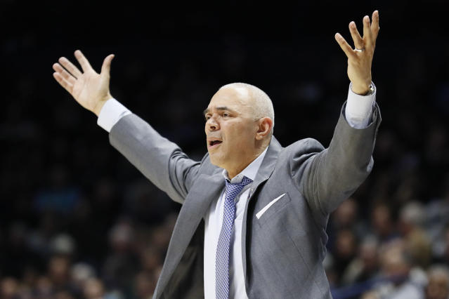 FILE - In this Feb. 9, 2019, file photo, DePaul head coach Dave Leitao reacts during the second half of an NCAA college basketball game, in Cincinnati. The NCAA suspended mens basketball coach Dave Leitao for the first three games of the regular season Tuesday, July 23, 2019, saying he should have done more to prevent recruiting violations by his staff. The NCAA also put the Big East program on three years of probation, issued a $5,000 fine and said an undetermined number of games will be vacated because DePaul put an ineligible player on the floor. An unidentified former associate head coach is also facing a three-year show cause order for his role in the violations.(AP Photo/John Minchillo, File)