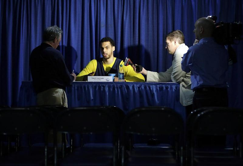 Marquette guard Trent Lockett, center, is interviewed by local media following his team's practice, Friday, March 29, 2013, in Washington. Marquette is scheduled to play Syracuse in a regional semifinal game in the NCAA college basketball tournament on Saturday. (AP Photo/Pablo Martinez Monsivais)
