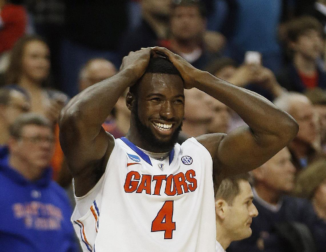 Florida center Patric Young (4) celebrates after the second half in a regional final game against Dayton at the NCAA college basketball tournament, Saturday, March 29, 2014, in Memphis, Tenn. Florida won 62-52. (AP Photo/John Bazemore)